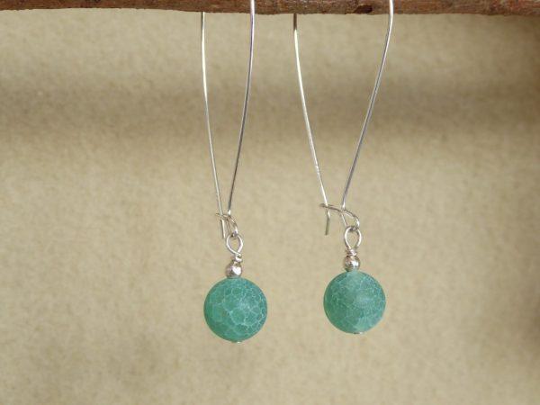 Large modern 46mm silver hoop earrings with green quartz drops