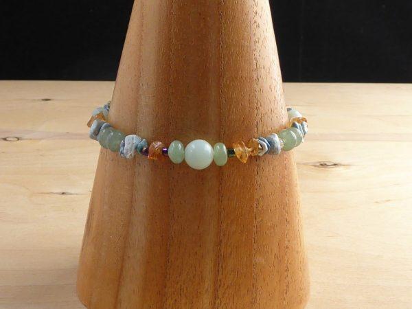 A blue-green bracelet of Amazonite, Aventurine, Citrine beads.
