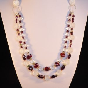 A sparkly 2 row necklace of rock crystal and red garnet