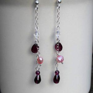 Earrings garnet and pearl on chain drop.
