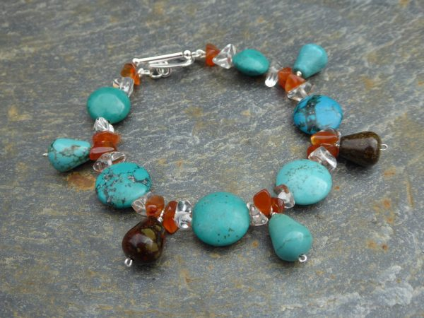 Turquoise bracelet with drops on slate background